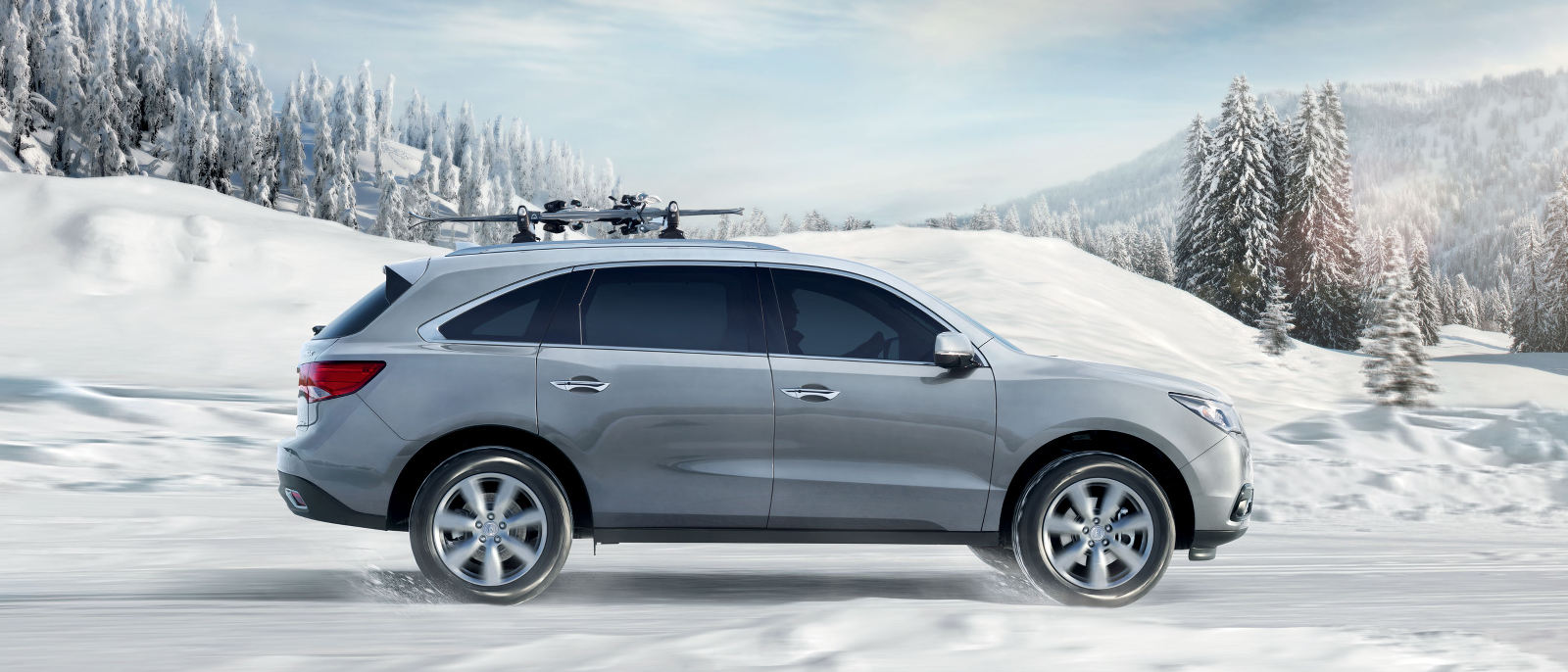 2015 Acura MDX driving on snow