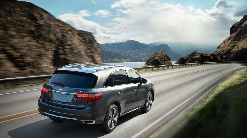 MDX driving toward mountains