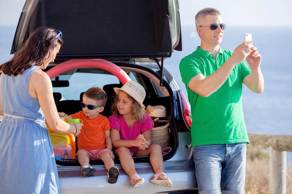 parents and kids with van