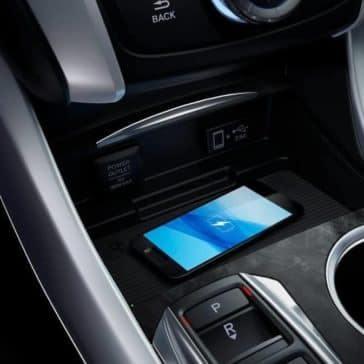 phone charging wirelessly in center console of 2019 Acura TLX