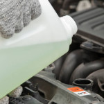 Pouring Coolant into Car