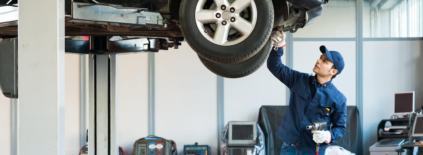 Portrait of a mechanic at work in a dealership service center