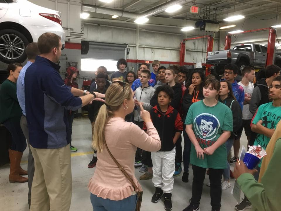 Students from local deaf & blind school learning at Beaver Toyota with help of ASL interpreter