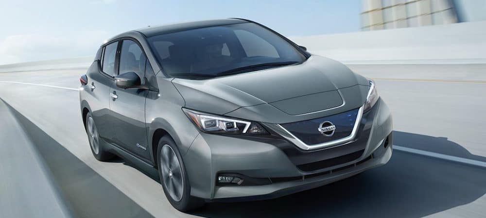 A 2018 Nissan Leaf driving down the highway