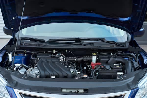 Car with open hood showing battery location