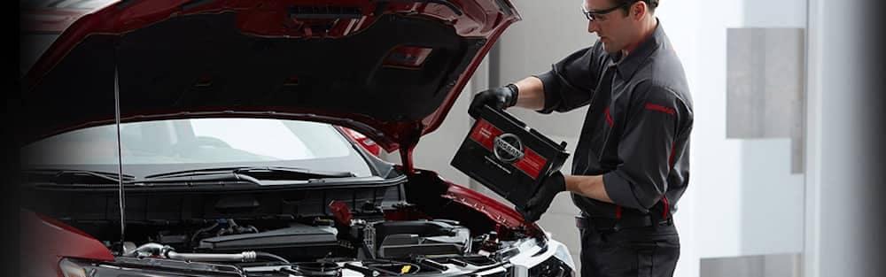 Nissan Service Technician Installing New OEM Nissan Battery
