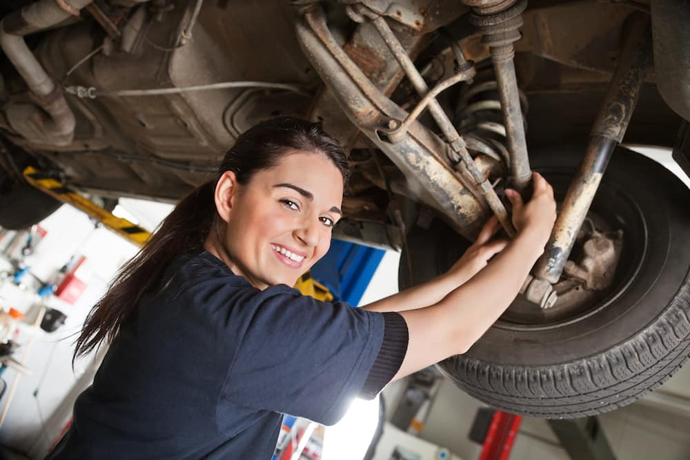 Female mechanic working on a vehicle