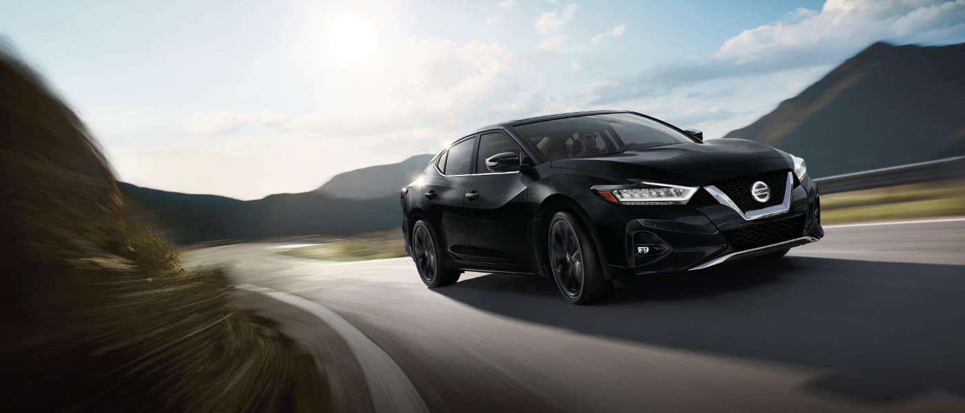 Black 2019 Nissan Maxima SR on road