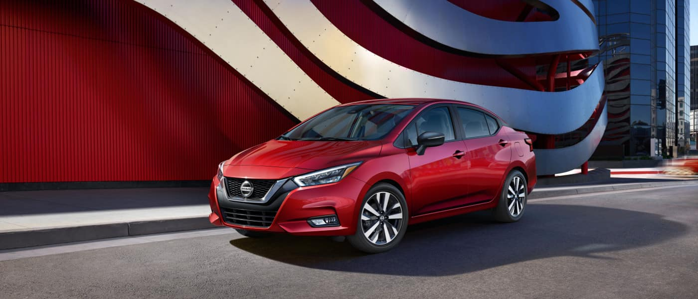 Red 2020 Nissan Versa parked