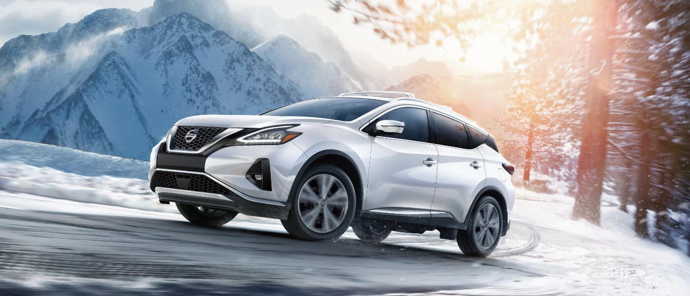 New White Nissan Murano in snow