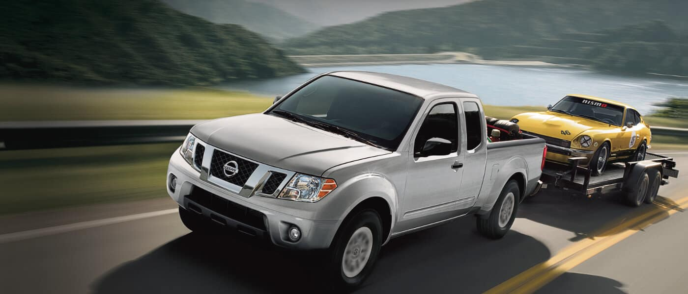 Silver 2019 Nissan Frontier on road