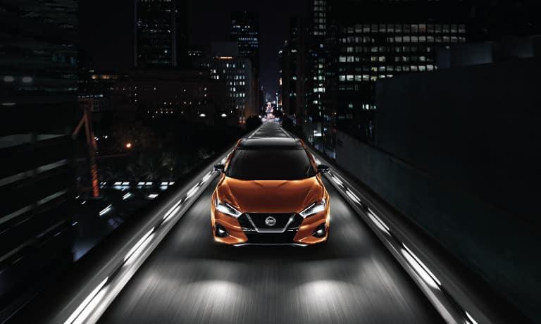 Orange 2020 Nissan Maxima on road