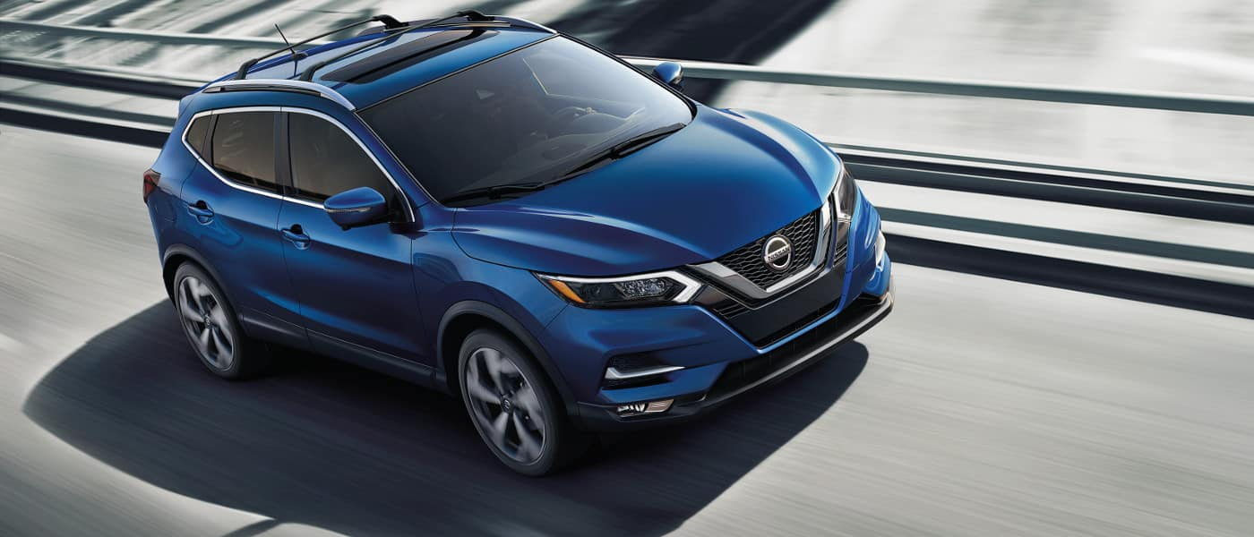 Blue 2020 Nissan Rogue Sport on highway