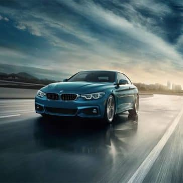 2019 BMW 4-Series driving at dusk