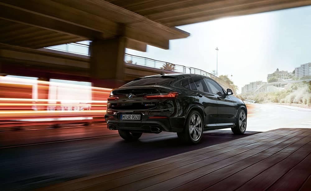 2019 BMW X4 driving under bridge
