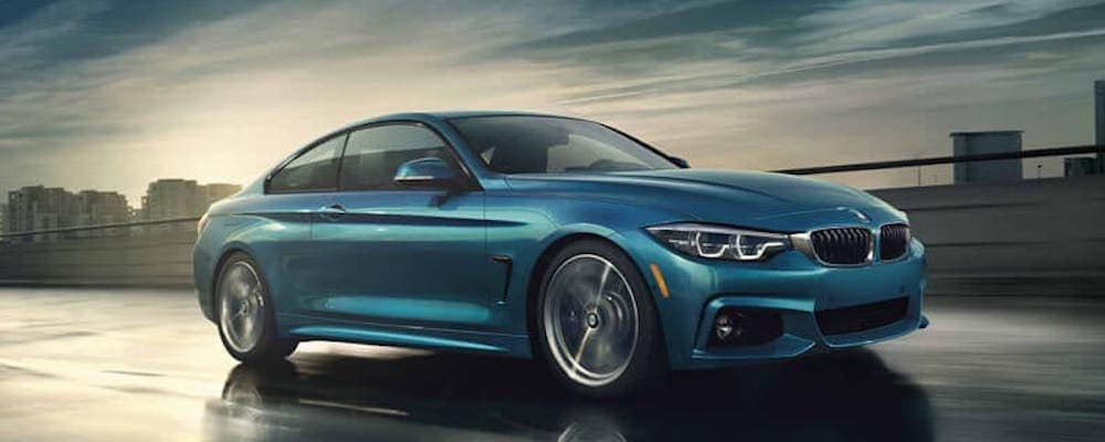 Blue BMW sedan on the road