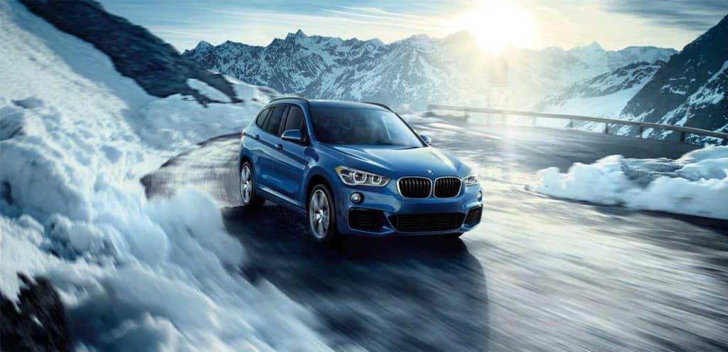 2019 BMW X1 xDrive28i accelerates around icy corner