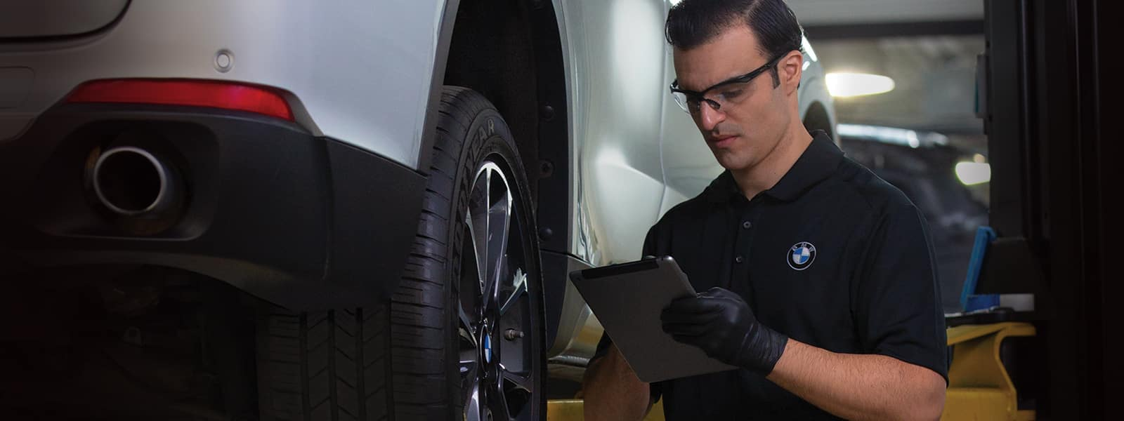 bmw certified technician reviewing file