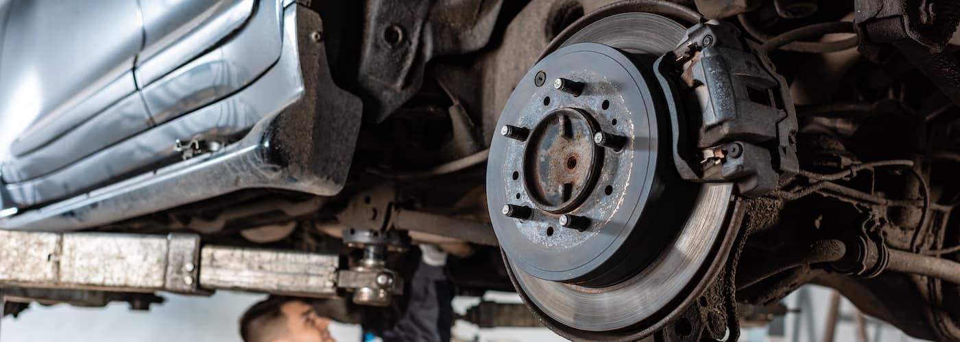 mechanic repairing brakes
