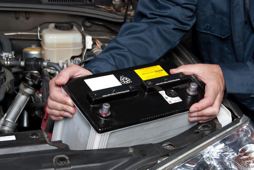 Mechanic changing battery