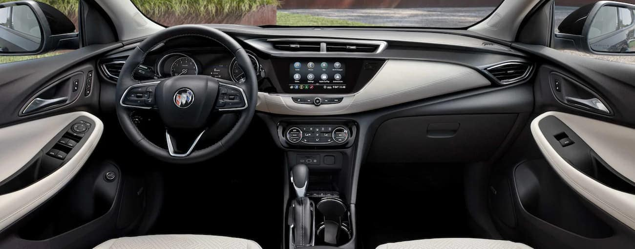 The black and white interior is shown in a 2021 Buick Encore GX.