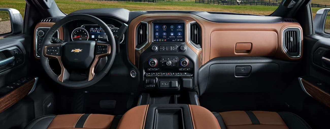 The black and brown interior of a 2021 Chevy Silverado 1500 is shown.