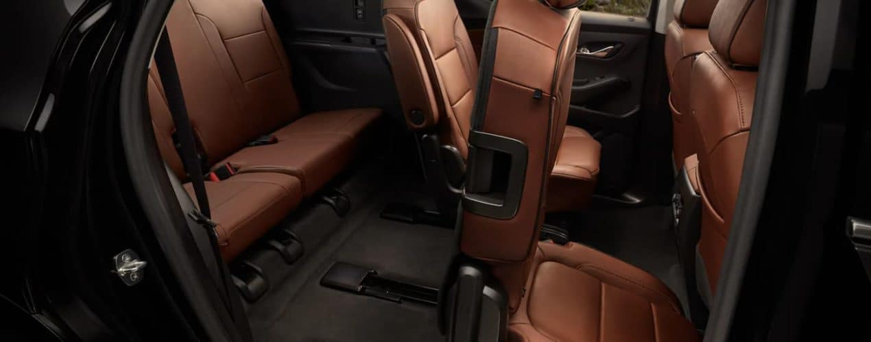 The brown interior is shown from the passenger side in a 2021 Chevy Traverse.