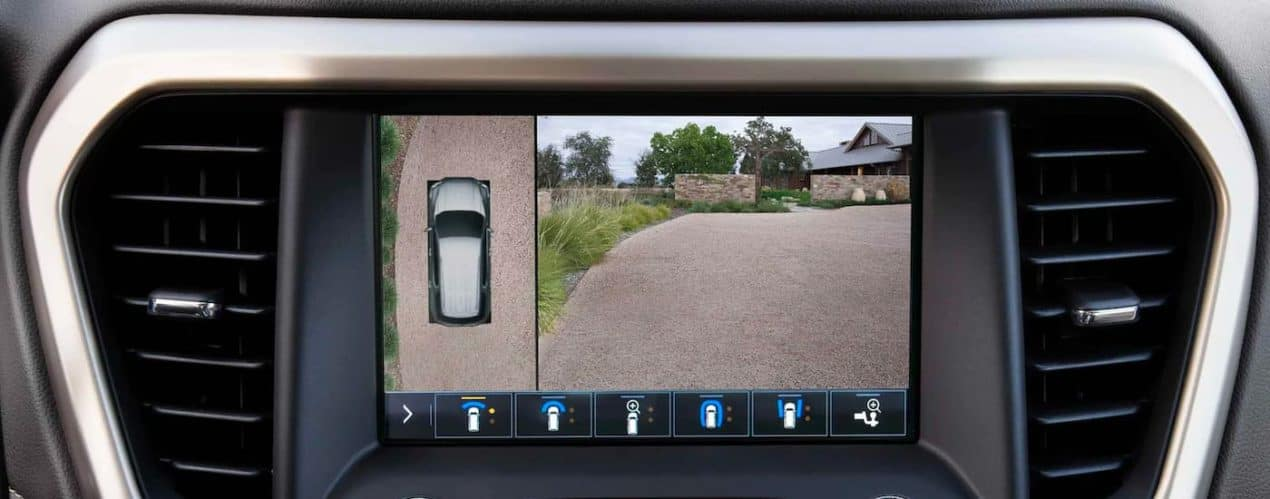 A close up shows a camera view on the infotainment screen on a 2021 GMC Acadia.