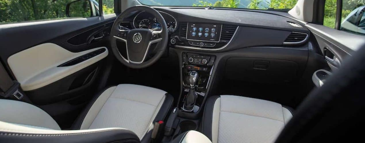 The white and black interior in a 2021 Buick Encore is shown.