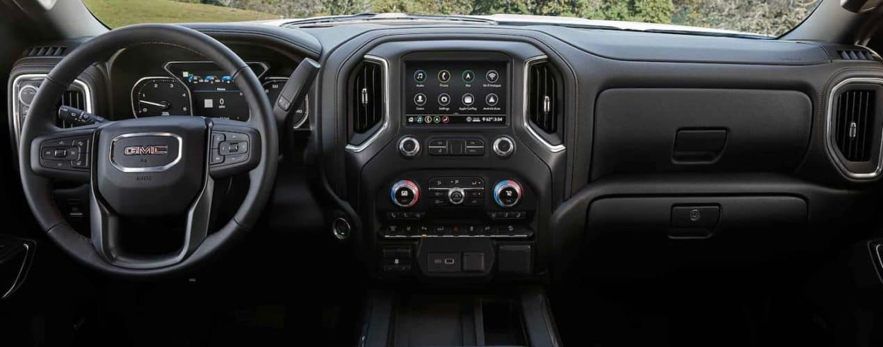The black dashboard and infotainment system is shown in a 2021 GMC Sierra 3500HD AT4.