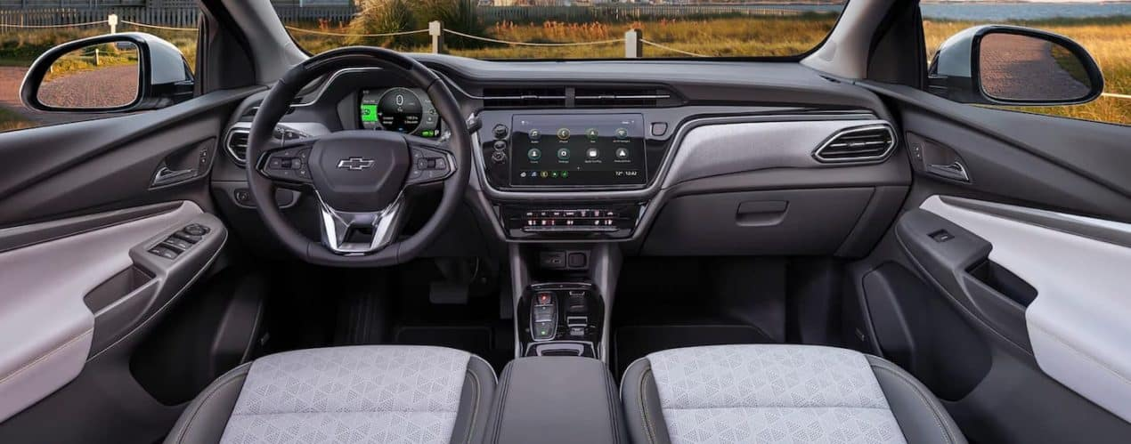 The black and gray front seats and dash board are shown in a 2022 Chevy Bolt EUV.
