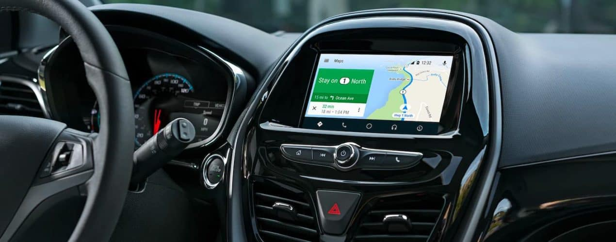 The infotainment screen with GPS is shown in a 2021 Chevy Spark.