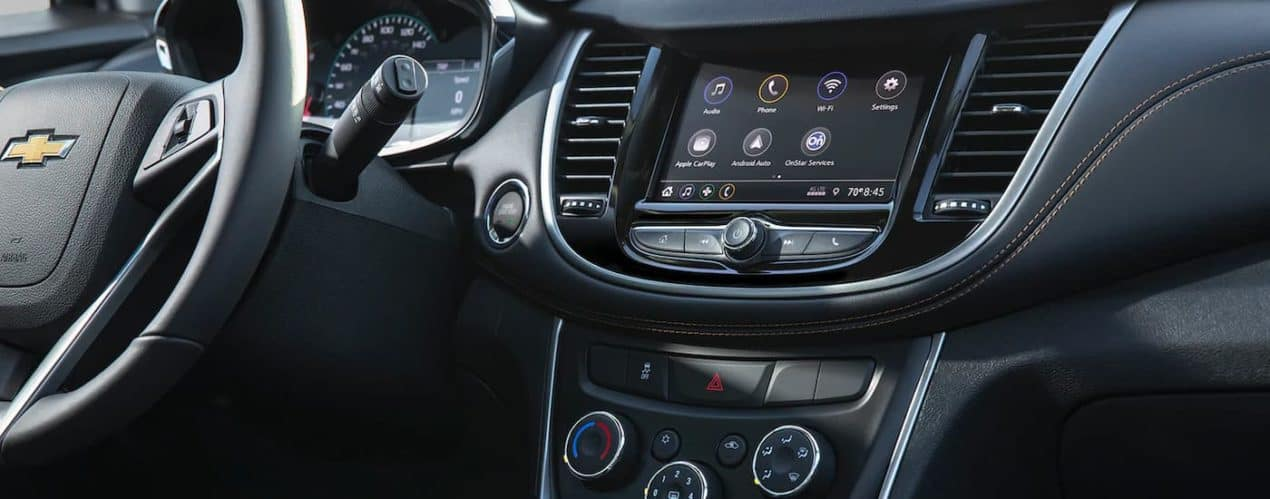 The steering wheel and infotainment screen are shown in a 2021 Chevy Trax.