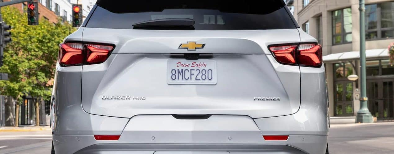 A white 2021 Chevy Blazer is shown from the rear in a city.