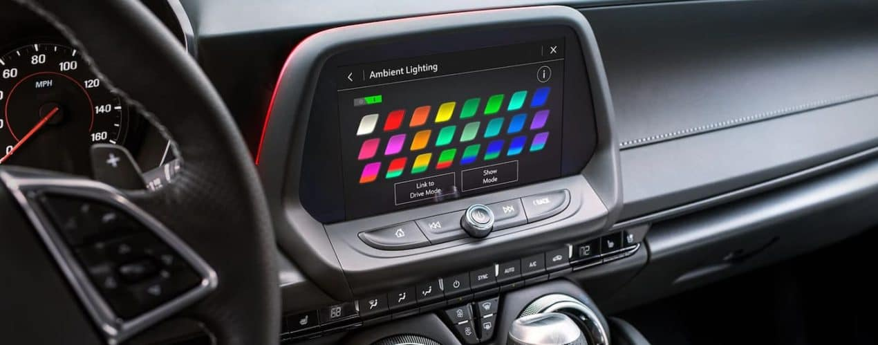 A close up shows the ambient lighting options on the infotainment screen in a 2021 Chevy Camaro.