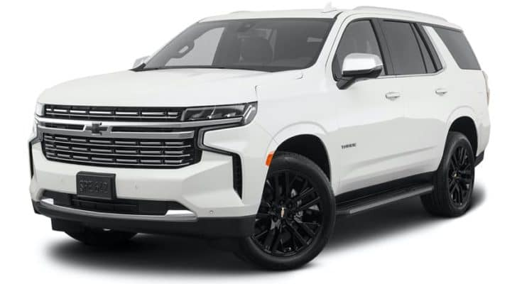 A white 2021 Chevy Tahoe Premier is angled left.