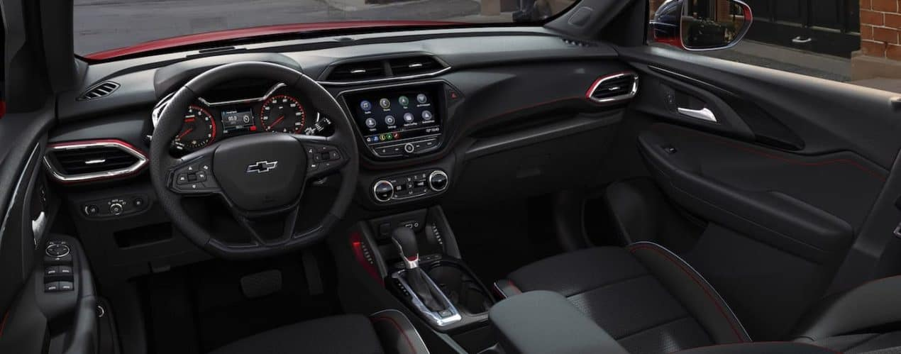 The front interior and dash is shown in a 2021 Chevy Trailblazer RS.