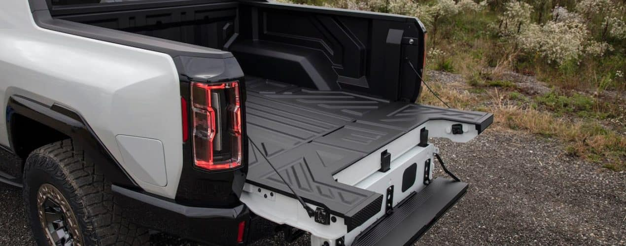 A close up shows the bed of a white 2022 GMC Hummer EV Pickup.