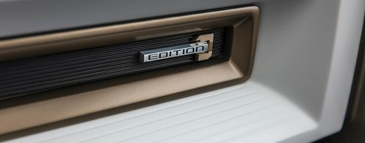 A close up shows the badge on a 2023 GMC Hummer EV SUV First Edition.