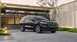 A black 2022 Buick Enclave i shown parked in a modern driveway.