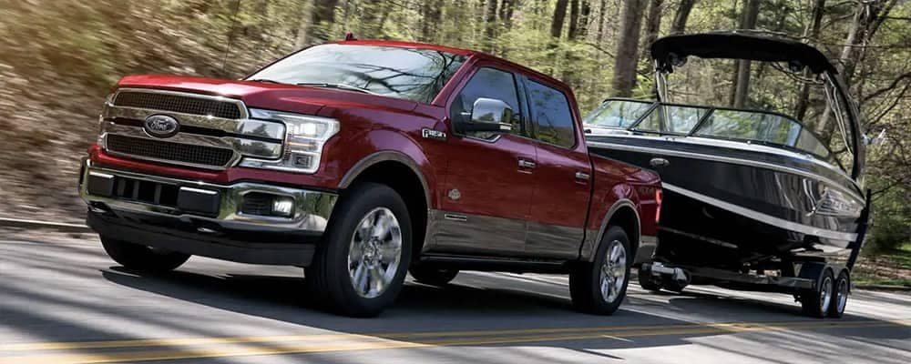 2019 Ford F-150 King Ranch in Ruby Red towing boat