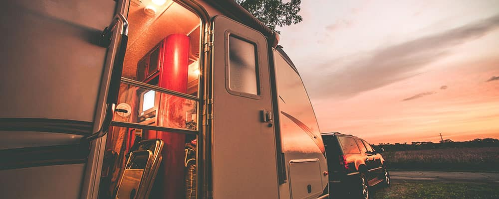 Travel Trailer Camping. RV Trip Theme. Evening in RV. Vintage Color Grading.