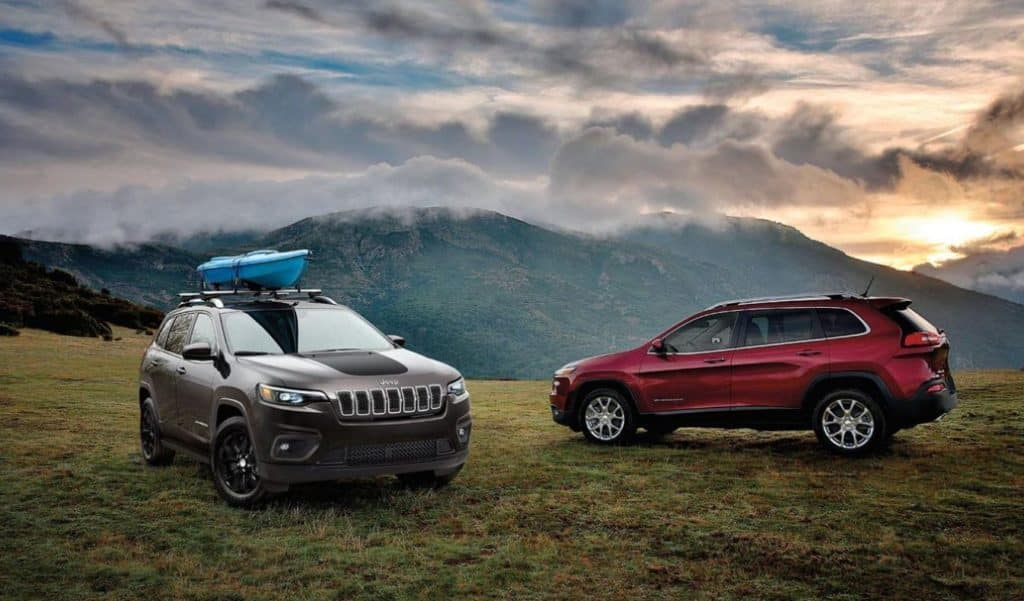 Two 2020 Cherokees parked up on a high hill