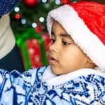 Young Boy in Santa Hat with Christmas Decorations