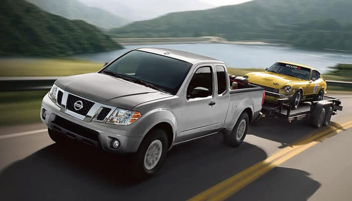 2018 Nissan Frontier Towing Car on Trailer
