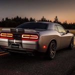 Challenger SRT® 392 features a body-color spoiler and dual rear exhaust with bright tips. Shown in Billet Silver Metallic with the available twin black center stripes.