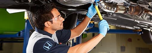 honda technician works on car