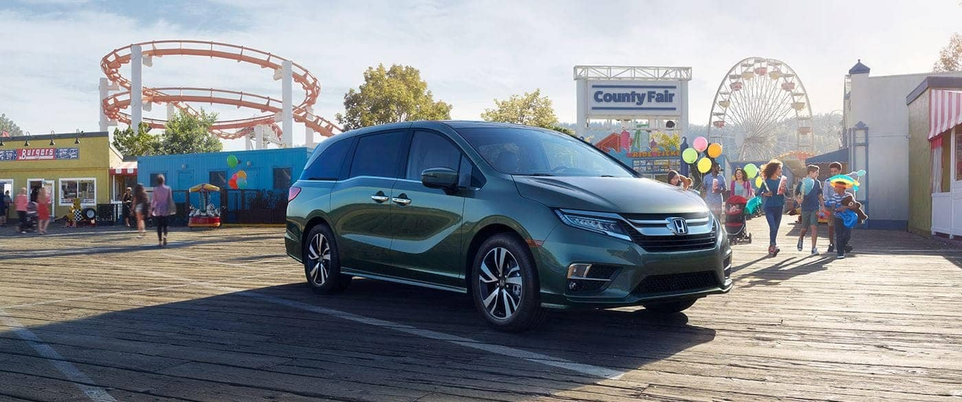 2018 Honda Odyssey parked outside an amusement park