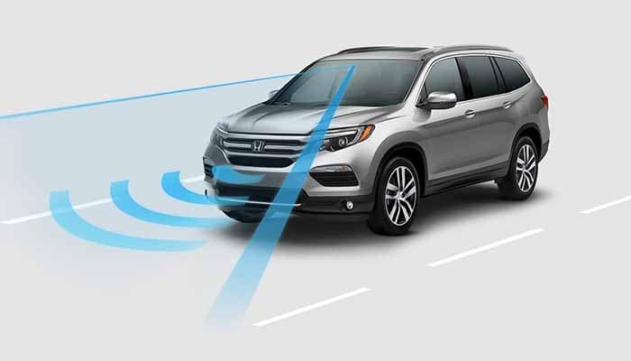 2019 Honda Pilot with Honda Sensing safety graphic overlay