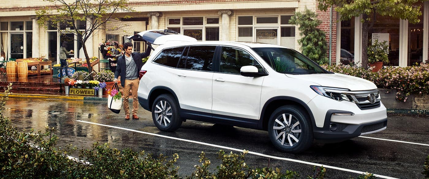 2019 Honda Pilot Man Putting Flowers In Trunk